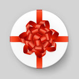 Vector White Round Gift Box with Shiny Orange Bow and Ribbon Top View  on Background Royalty Free Stock Photography