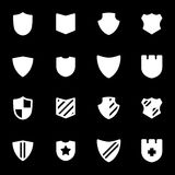 Vector white shield icons set. On black background Royalty Free Stock Photos