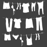 Vector White Silhouettes of Laundry on a Rope Stock Photo