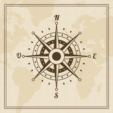 Vector Wind rose on a world map background Stock Photos
