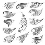 Vector wings isolated on white background. Cartoon tattoo, tribal and vintage heraldic wing set Stock Photos