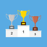 Vector winners podium with gold, silver and bronze trophy cups or awards. Winners podium with gold, silver and bronze trophy cups or awards. Vector illustration Royalty Free Stock Photography