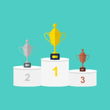 Vector winners white round podium with gold, silver and bronze trophy cups or prizes. Stock Images