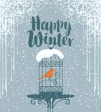 Winter banner with red bird in the cage Royalty Free Stock Photo