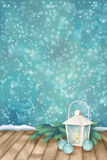 Vector Winter Christmas Scene Background. Xmas landscape with fir tree branches, lantern, baubles, snowflakes, textured wooden floor on abstract bokeh backdrop Royalty Free Stock Photo