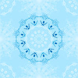 Vector winter pattern of snowflakes and mandalas. Royalty Free Stock Images