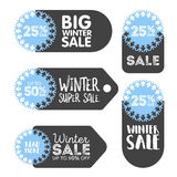 Vector winter sale and discount snowflake promotional stickers.  Stock Photos
