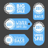 Vector winter sale and discount snowflake promotional stickers.  Royalty Free Stock Image