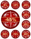 Vector winter sale tags with 5 - 85 percent text. Sale tags for christmas or new year or winter sale out. Percentage discount rounded to five. Isolated red set royalty free illustration