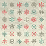 Vector Winter Snow Flakes Doodles on Crumpled Royalty Free Stock Photography