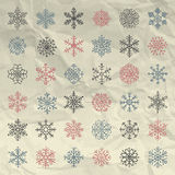 Vector Winter Snow Flakes Doodles on Crumpled Paper Stock Photos