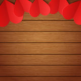Vector wooden background with red paper hearts Stock Photos