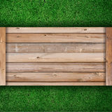 Vector wooden board on green grass Royalty Free Stock Photography