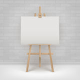 Vector Wooden Brown Sienna Easel with Mock Up Empty Blank Horizontal Canvas Standing on Floor in front of Wall Royalty Free Stock Images