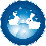 Vector Xmas rabbit drawing. Design of a plate by New Year 2011. White rabbits are played in snowdrifts Stock Images