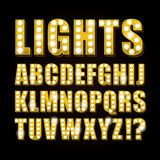 Vector yellow neon lamp letters font show casino or theater Royalty Free Stock Photos