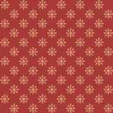 Vector yellow snowflakes seamless pattern on the red background. New Year decoration. Royalty Free Stock Photo