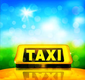 Vector yellow taxi sign on the car on a blue sky background and Royalty Free Stock Photos