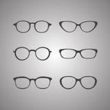 Vector zwarte die glazenpictogrammen op witte achtergrond worden geplaatst Royalty-vrije Stock Foto's