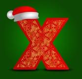 Vectoralfabetbrief X met Kerstmishoed en gouden sneeuwvlokken Royalty-vrije Stock Foto
