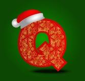 Vectoralfabetbrief Q met Kerstmishoed en gouden sneeuwvlokken Stock Afbeelding