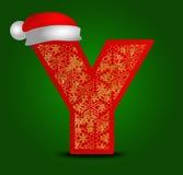 Vectoralfabetbrief Y met Kerstmishoed en gouden sneeuwvlokken Stock Afbeeldingen