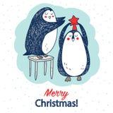 Vectorhand getrokken prentbriefkaar met twee leuke pinguïnen vector illustratie