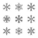Vectorinzameling van sneeuwvlokken, zwart pictogram op een witte achtergrond Royalty-vrije Stock Fotografie