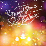 Vectormalplaatje met het van letters voorzien wensen wij u Vrolijke Kerstmis Abstract onduidelijk beeld en bokeh kleurrijke achte Royalty-vrije Stock Afbeelding