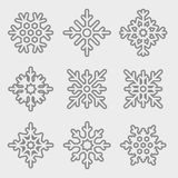 Vectorreeks lineaire sneeuwvlokken Dunne lijnsneeuwvlokken Stock Afbeeldingen