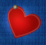 Vectors jeans background with red heart Stock Photography