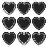 Vectors set with black heart shaped tags. With white floral borders in chalkboard style for labels, tags and product packaging royalty free illustration