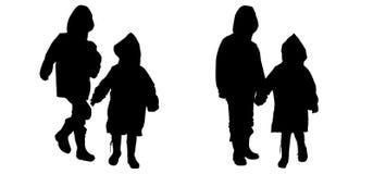 Vectorsilhouet van kinderen in regenjassen Royalty-vrije Stock Afbeeldingen