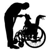 Vectorsilhouetten van hond in een rolstoel Stock Foto