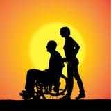 Vectorsilhouetten van mensen in een rolstoel Royalty-vrije Stock Afbeelding