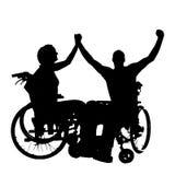 Vectorsilhouetten van mensen in een rolstoel Stock Fotografie