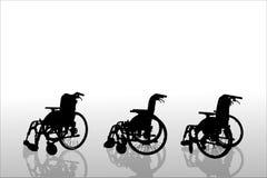 Vectorsilhouetten van rolstoel Stock Foto's