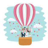 Vedding couple in hot air balloon Stock Images