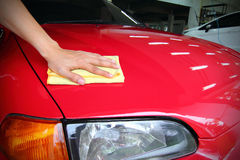 Veeg de rode auto af Royalty-vrije Stock Foto