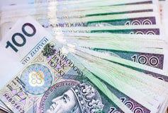 Veel bankbiljetten honderd zloty poetsmiddel Stock Afbeelding