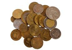 Veel muntstukken op een witte achtergrond Stock Foto