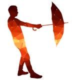 Veelhoeksilhouet van een mens met een paraplu Stock Fotografie