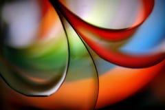 Veelkleurige document vorm in motie stock afbeelding