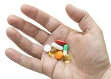 Veelkleurige pillen in uw palm Royalty-vrije Stock Foto's