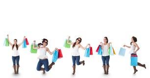 Veelvoudig beeld van vrouw met het winkelen zakken tegen witte achtergrond stock foto's