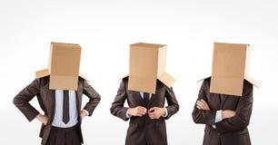 Veelvoudig beeld van zakenlieden met kartondozen die hoofd behandelen royalty-vrije stock foto