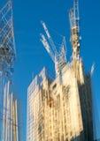 Veelvoudig blootstellingsbeeld van bouwconstructieplaats in het centrum van Londen Kranen en concrete samentrekking tegen van bla royalty-vrije stock foto's