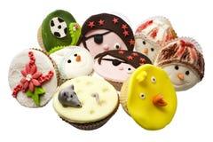 Veelvoudige cupcakes die over wit wordt geïsoleerde stock afbeeldingen