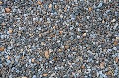 Veelvoudige kleine stenen in verschillende schaduwen Stock Afbeeldingen
