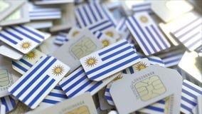 Veelvoudige Simkaarten met vlag van Uruguay Het Uruguayan mobiele telecommunicatie conceptuele 3D teruggeven stock illustratie